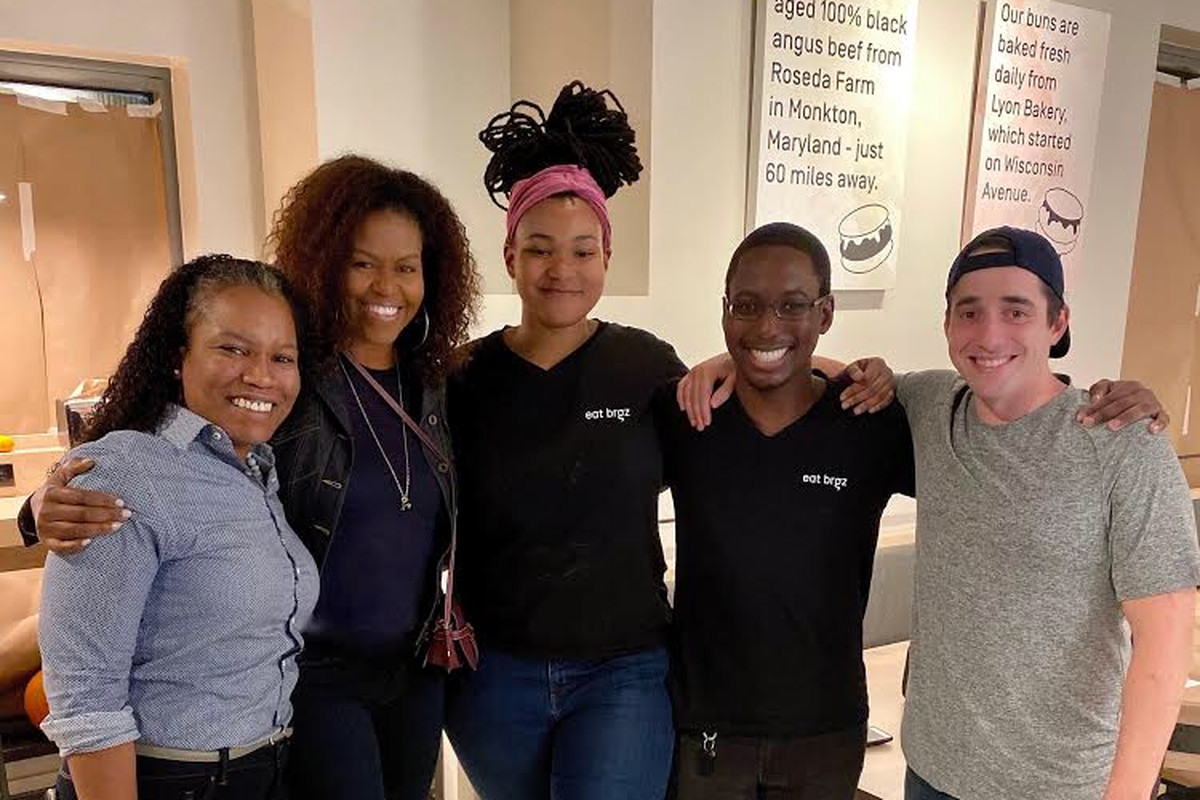 Michelle Obama poses with Eat Brgz staff and owner Brandon Gaynor.