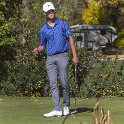 Bode Salas, of Carbon High School, pumps his fist after rolling in a birdie putt on the 18th hole giving him two-shot victory during the 3A boys state golf championship at Round Valley Golf Course in Morgan on Thursday, Oct. 8, 2020.
