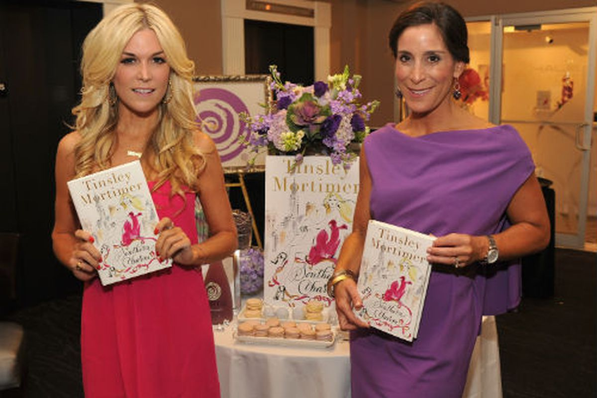 The Tinz, at left, with her new book. Photo via Getty.