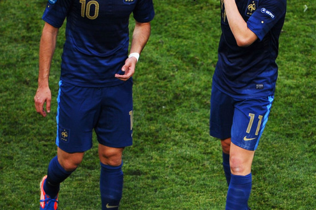 DONETSK, UKRAINE - JUNE 11:   Karim Benzema  and Samir Nasri of France talk during the UEFA EURO 2012 group D match between France and England at Donbass Arena on June 11, 2012 in Donetsk, Ukraine.  (Photo by Lars Baron/Getty Images)