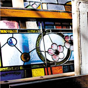 <p><strong>TOH Tip:</strong> To clean hard-to-reach crevices on stained-glass windows, dip a Q-tip in denatured alcohol and gently wipe away dust and dirt.</p>