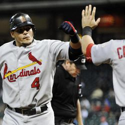 St. Louis Cardinals' Yadier Molina (4) is congratulated by Matt Carpenter (13) on a solo home run against the Houston Astros in the fourth inning of a baseball game, Monday, Sept. 24, 2012, in Houston.