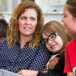 Heidi Wallis sits with three of her kids — Bubba, Sam and Ellie  — during an interview at their home in Bluffdale on Wednesday, Nov. 2, 2016. Heidi Wallis and her husband, Trey, are fighting to have GAMT screening placed on the national newborn screening list. Two of their children, Sam and Louie, have the rare disease guanidinoacetate methyltransferase (GAMT) deficiency.