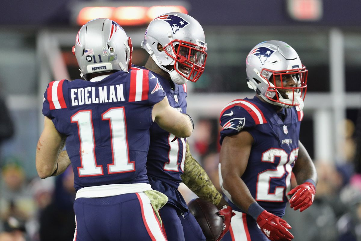 Josh Gordon of the New England Patriots celebrates with Julian Edelman after scoring a 55-yard receiving touchdown during the fourth quarter against the Green Bay Packers at Gillette Stadium on November 4, 2018 in Foxborough, Massachusetts.