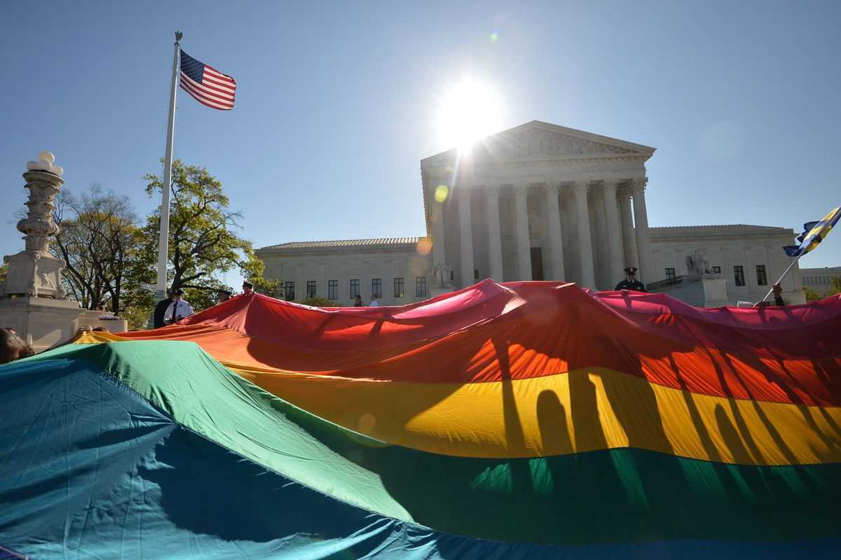 The Supreme Court, covered by an LGBT flag.