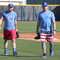 David Bote and Kyle Schwarber return from shagging balls in the outfield on Field 1 at Riverview Park, the Spring Training home of the Chicago Cubs, in Mesa, AZ.   John Antonoff/For the Sun-Times