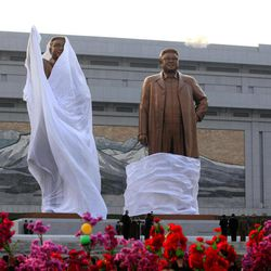 North Korean leaders attend the unveiling ceremony for statues of late leaders Kim Il Sung, left, and Kim Jong Il, right, on Mansudae in Pyongyang, North Korea, Friday, April 13, 2012.