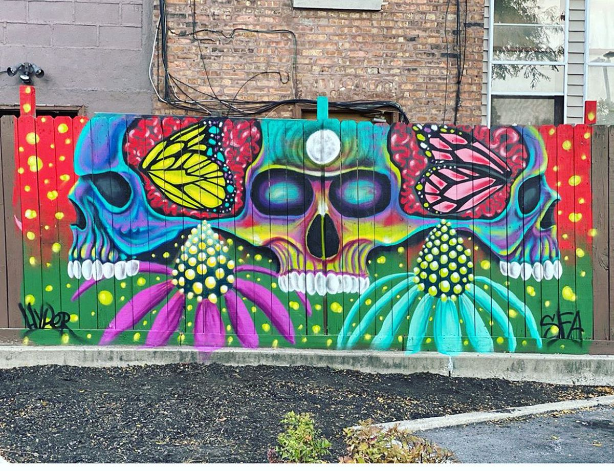 This work by Mario Mena, head of the Gage Park Mural Project, combines butterfly wings and traditional Mexican skull imagery in a display of reds and greens.