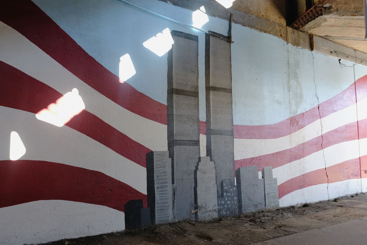 A mural underneath the Long Island Rail Road trellis in Woodside, Queens, one of many painted on that wall to honor Sept. 11 in 20 years.