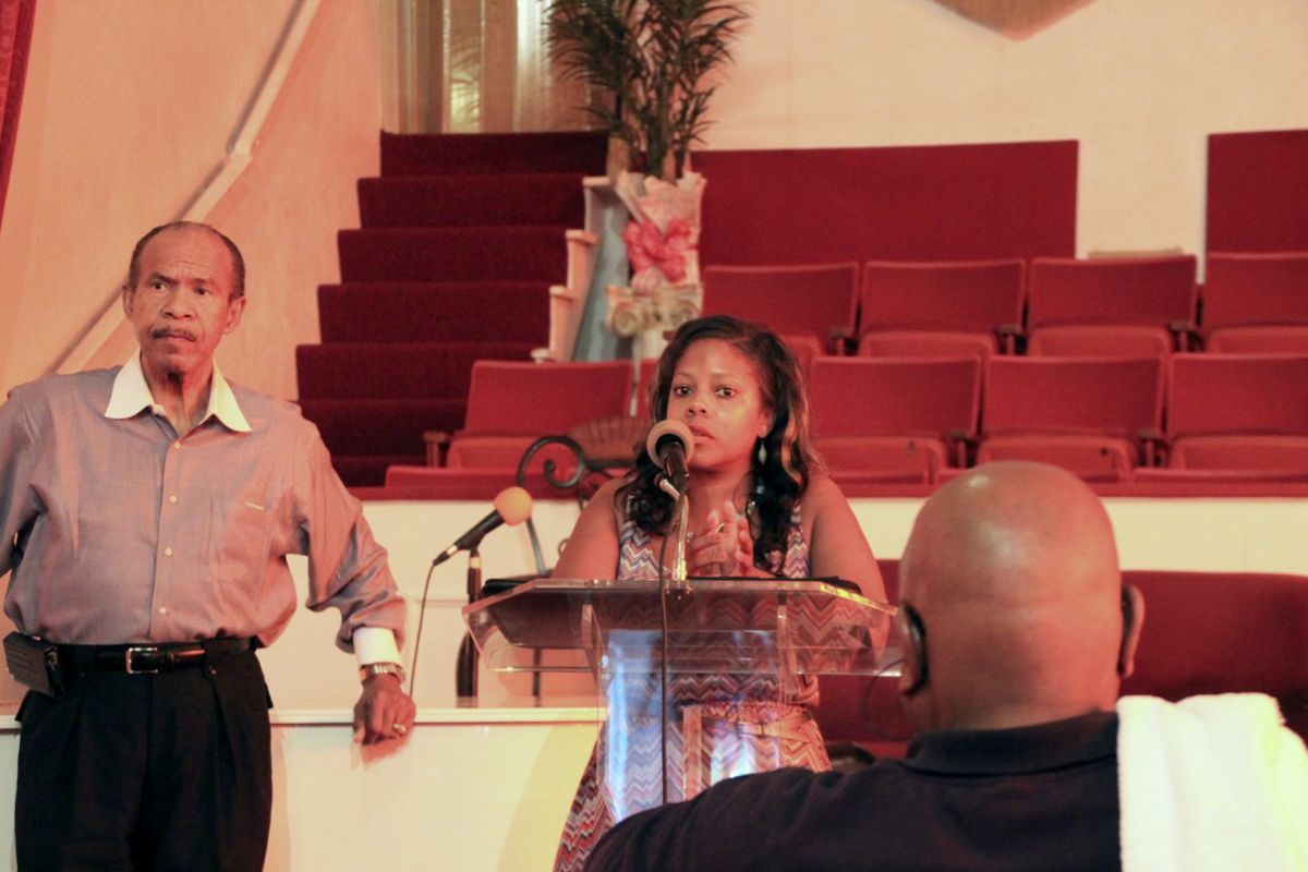 School board member Shante Avant answers questions about shuttered Carver High School from community members in Memphis with Ralph White.