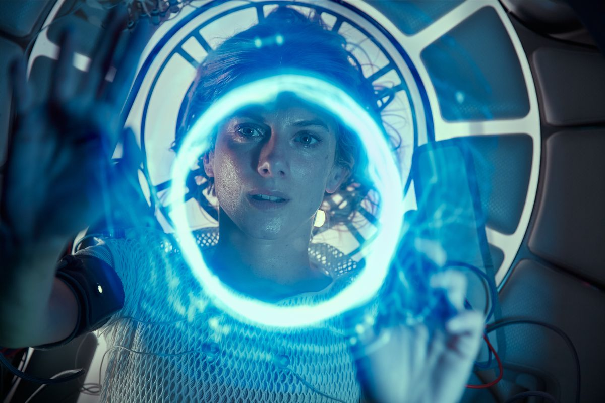 Mélanie Laurent seen through a ring of blue light in her cryo-pod in Oxygen