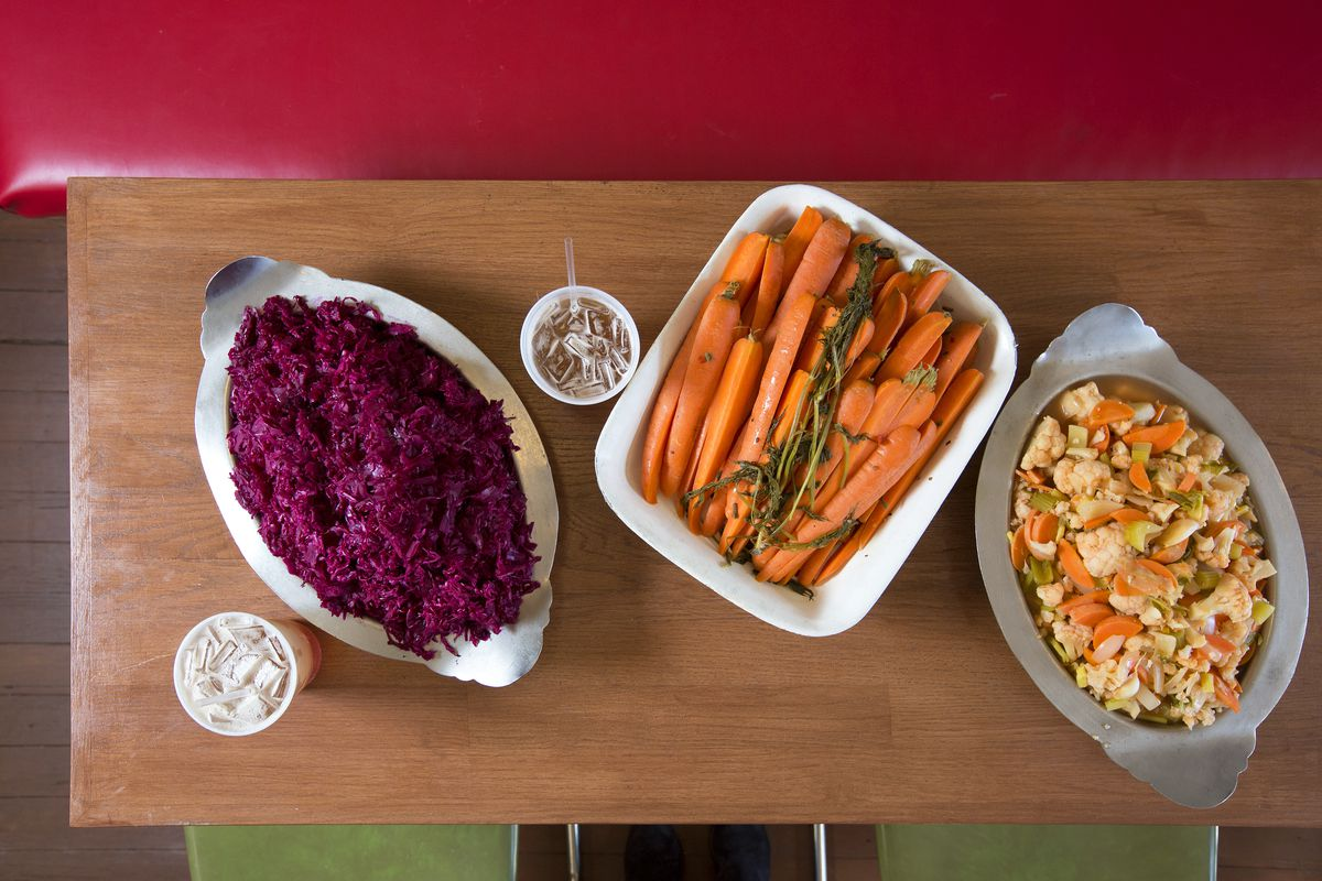 Dishes of cabbage, carrots, and cauliflower on a table at Larder