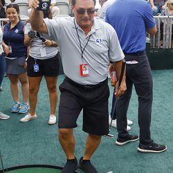 WFSB's Joe Zone pretends he's flying a drone for coverage of the hole in the mini golf tournament.