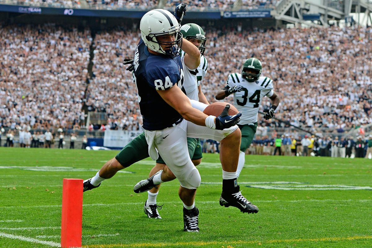 Sep 1, 2012; University Park, PA, USA; Penn State Nittany Lions tight end Matt Lehman (84) dives into the end zone for a touchdown in the second quarter against the Ohio Bobcats at Beaver Stadium. Mandatory Credit: Andrew Weber-US Presswire