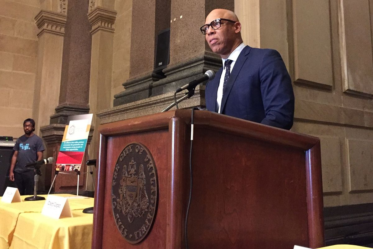Superintendent William Hite standing at a podium.