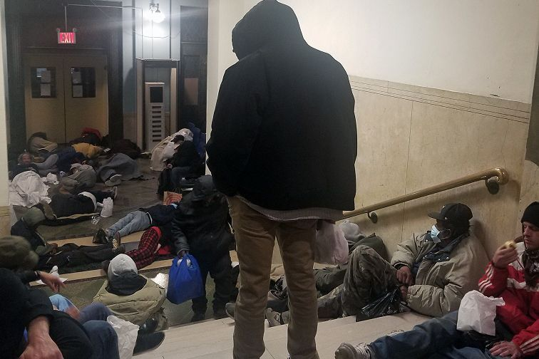 Homeless people were packed into the 30th Street Men's Shelter in Manhattan.