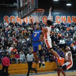 Simeon's Kejuan Clements (0) races to the basket against Young's Tyler Beard (24), Wednesday 02-13-19. Worsom Robinson/For the Sun-Times.