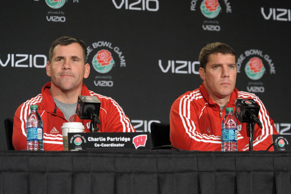 Chris Ash is most likely gone, but could Charlie Partridge (left) be lured back to Wisconsin?