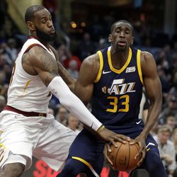 Utah Jazz's Ekpe Udoh (33) tries to get past Cleveland Cavaliers' LeBron James (23) in the first half of an NBA basketball game, Saturday, Dec. 16, 2017, in Cleveland. (AP Photo/Tony Dejak)