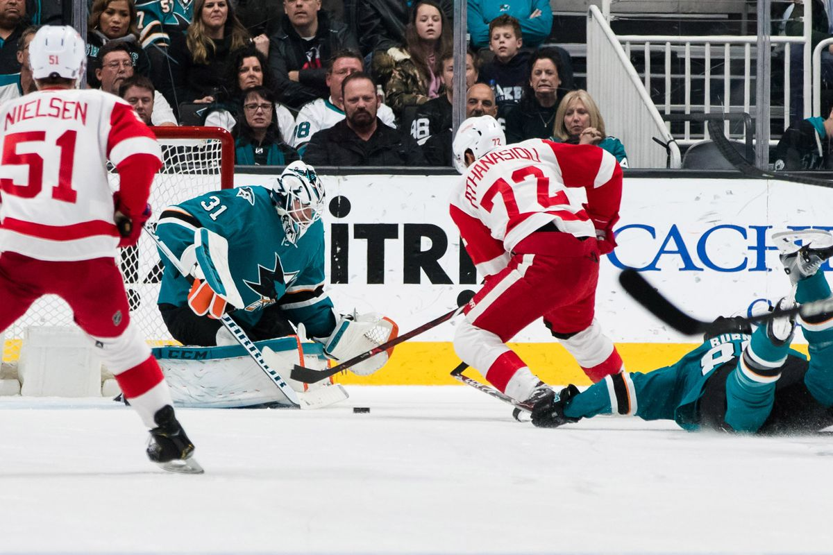 Mar 25, 2019; San Jose, CA, USA; Detroit Red Wings center Andreas Athanasiou (72) shoots and scores a goal against San Jose Sharks goaltender Martin Jones (31) in the second period at SAP Center at San Jose.