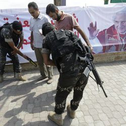 Lebanese Army soldiers search citizens outside Rafik Hariri international airport during a security measure, in Beirut, Lebanon, Friday Sept. 14, 2012. Pope Benedict XVI is expected to arrive in Lebanon for a three day visit to encourage his flock in the Middle East. He will also meet with Lebanese authorities as well as Christians from Lebanon and other nearby countries.