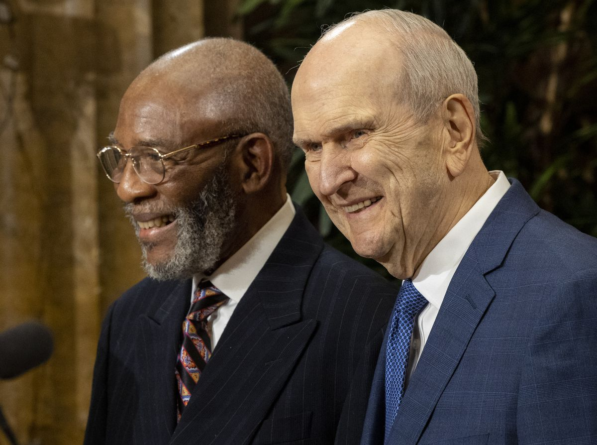 The Rev. Amos C. Brown of the NAACP and President Russell M. Nelson stand together at a news conference.
