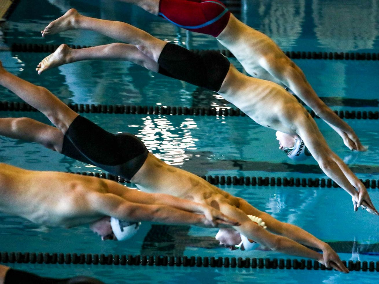 Swimmers race in the 500-yard freestyle at the 5A boys swimming state meet at the Wasatch Aquatic Center in Heber City on Saturday, Feb. 20, 2021.