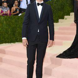 Ansel Elgort wears a Chanel suit.