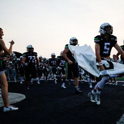 Ridgeline players take the field during a high school football game against Sky View at Ridgeline High School in Millville on Thursday, Sept. 17, 2020.