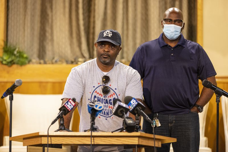 Former Jackie Robinson West coach Darold Butler speaks about the settlement of legal disputes involving the Jackie Robinson West Little League team. Behind him is coach Jerry F. Houston.