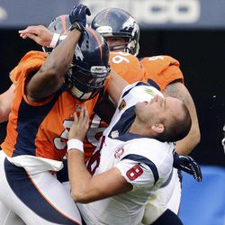 In this Sunday, Sept. 23, 2012, photo, Denver Broncos linebacker Joe Mays, left, knocks Houston Texans quarterback Matt Schaub's helmet off on a hit during the third quarter of their NFL football game in Denver. Mays received a one-game suspension and a $50,000 fine from the NFL for the hit that dislodged Schaub's helmet and took off a piece of his ear.