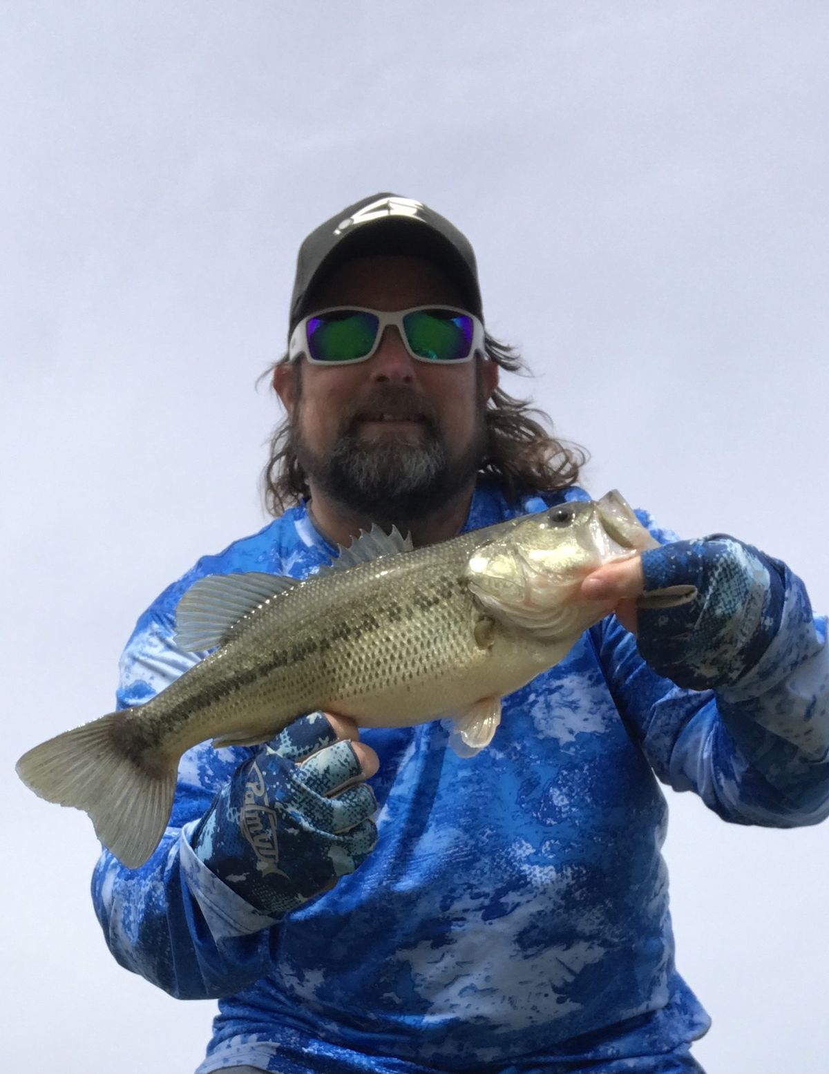"""Ken """"Husker"""" O'Malley with a local largemouth bass. Provided photo"""