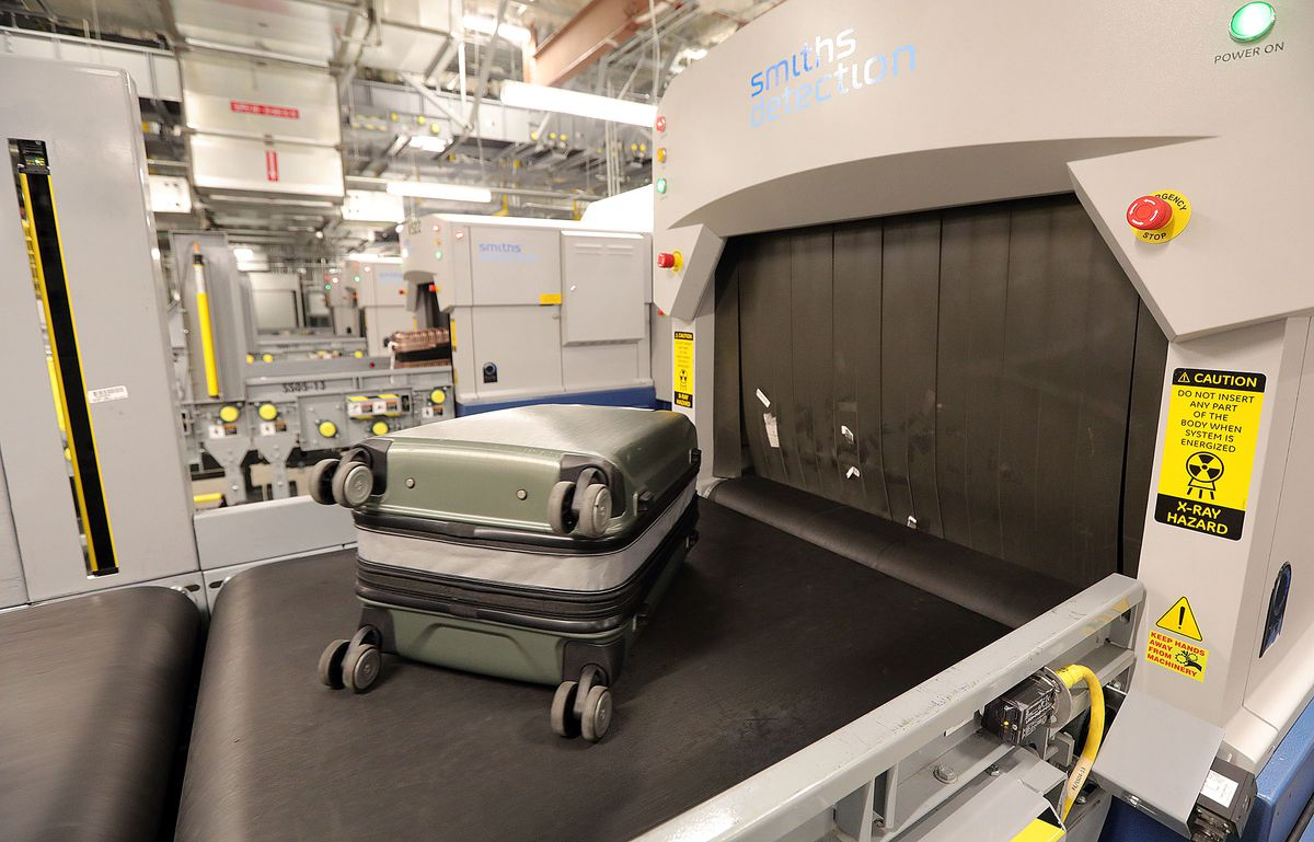 A checked bag moves into a CT scanner at the airport in Salt Lake City on Thursday, Aug. 26, 2021.The scanners are part of increased security measures implemented after the Sept. 11 attack.