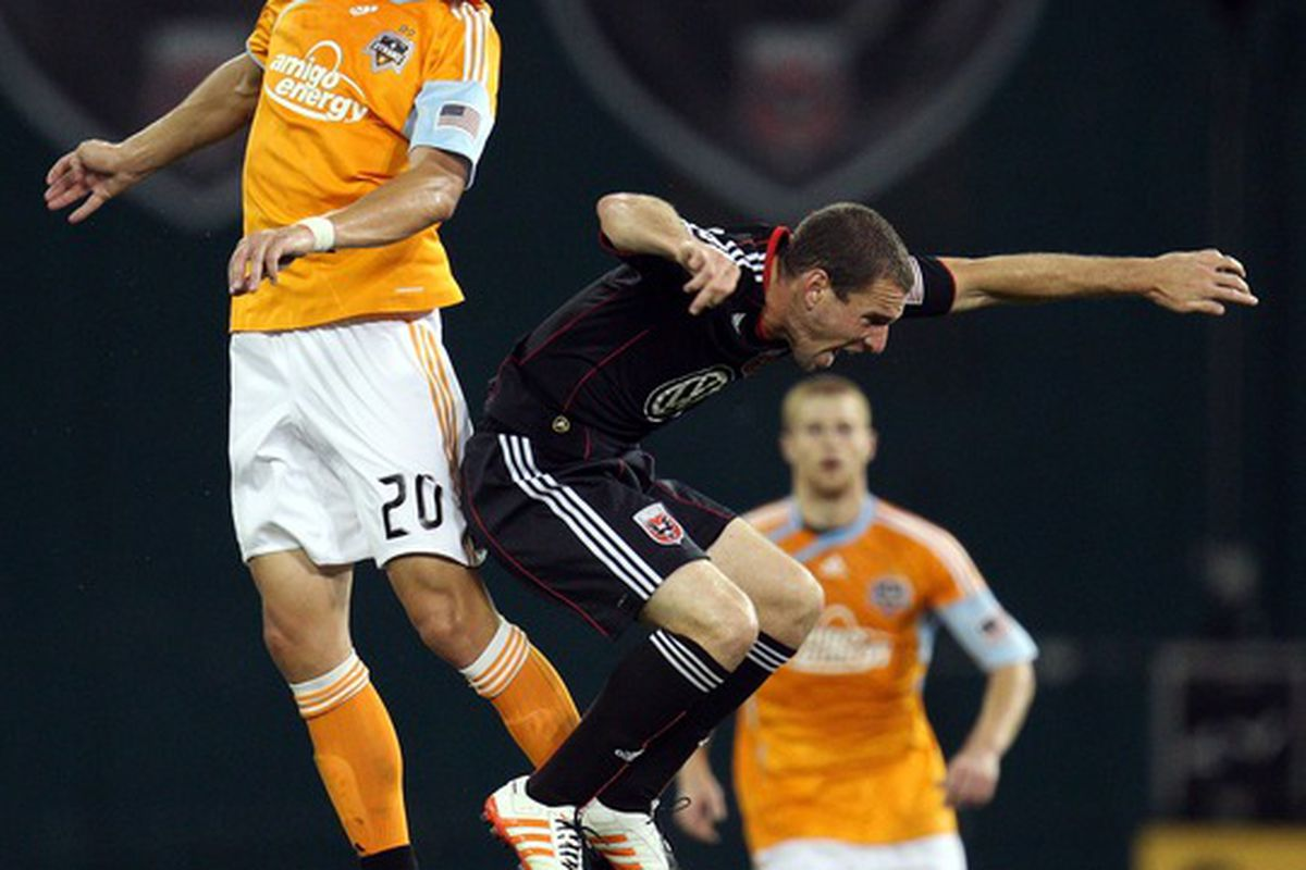 WASHINGTON - SEPTEMBER 25: Geoff Cameron #20 of the Houston Dynamo heads the ball against Kurt Morsink #6 of D.C. United at RFK Stadium on September 25 2010 in Washington DC. (Photo by Ned Dishman/Getty Images)