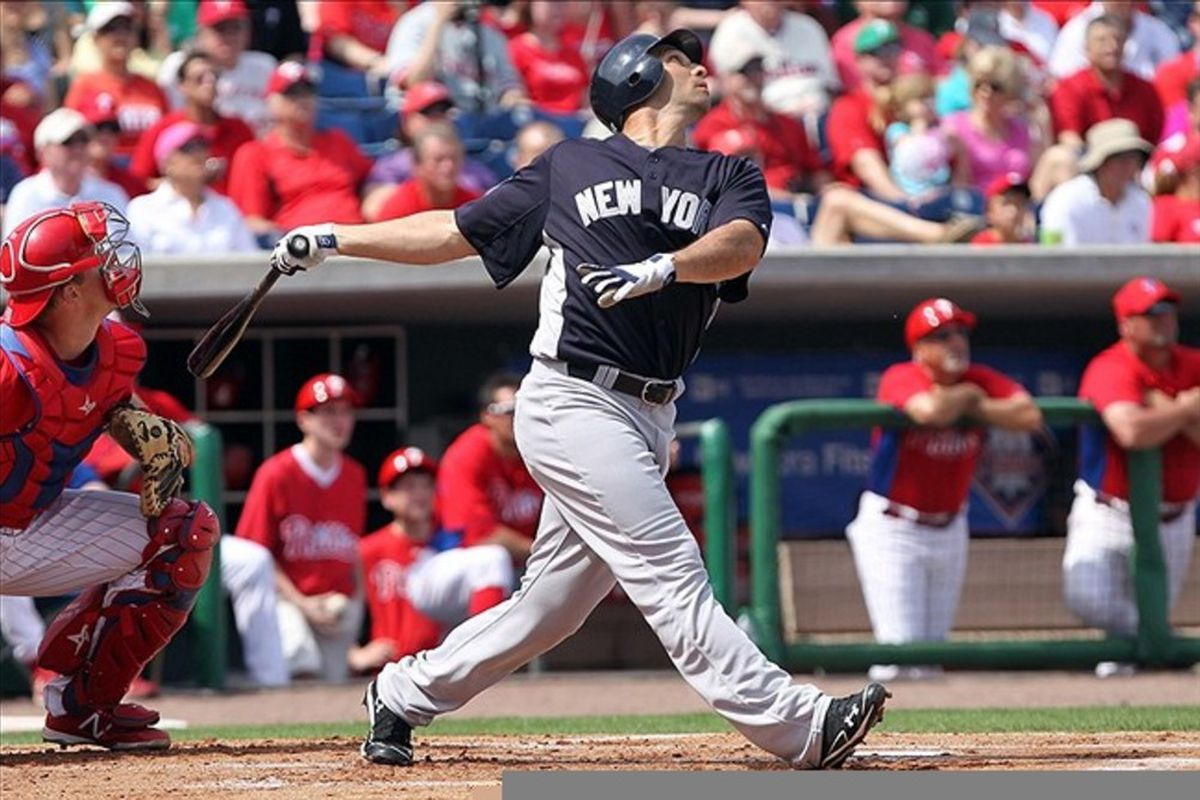 March 3, 2012; Clearwater, FL, USA; New York Yankees left fielder Raul Ibanez (27) hits an RBI double in the first inning against the Philadelphia Phillies at Bright House Networks Field.  Mandatory Credit: Kim Klement-US PRESSWIRE