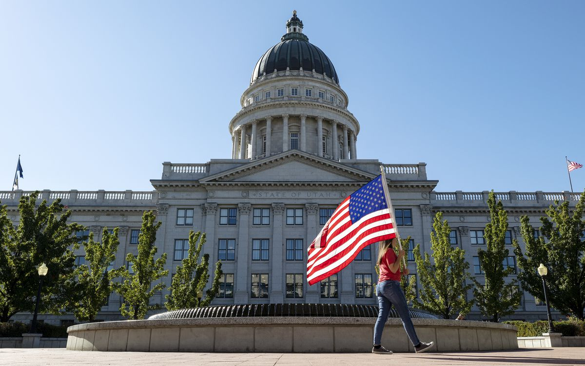People protest President Biden's vaccine mandate at the Utah State Capitol.