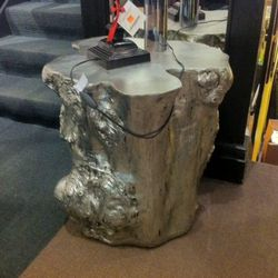 A silver-leafed 75-pound tree stump