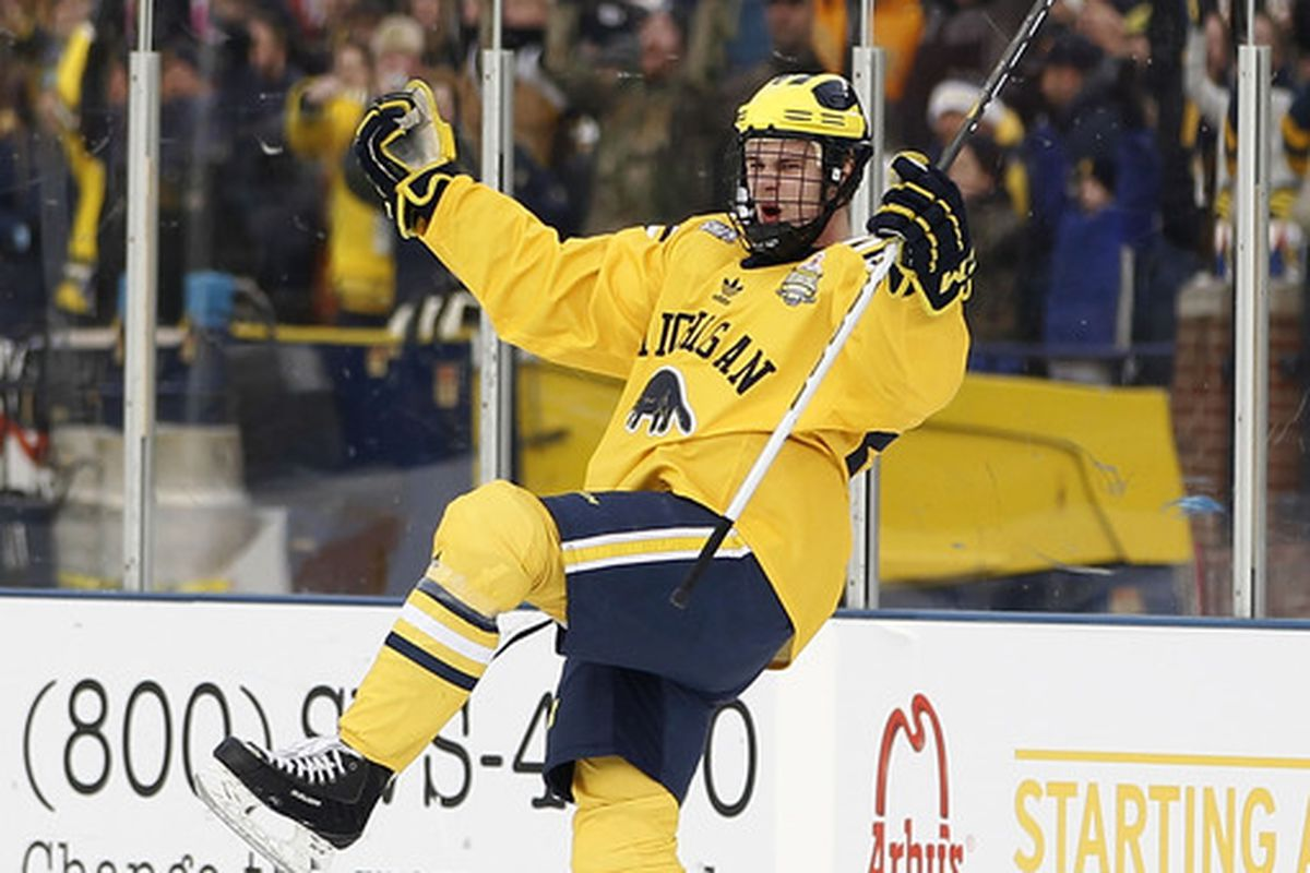 ANN ARBOR MI - DECEMBER 11:  Jon Merrill #24 of the Michigan Wolverines celebrats a first period goal while playing the Michigan State Spartans at Michigan Stadium on December 11 2010 in Ann Arbor Michigan.  (Photo by Gregory Shamus/Getty Images)