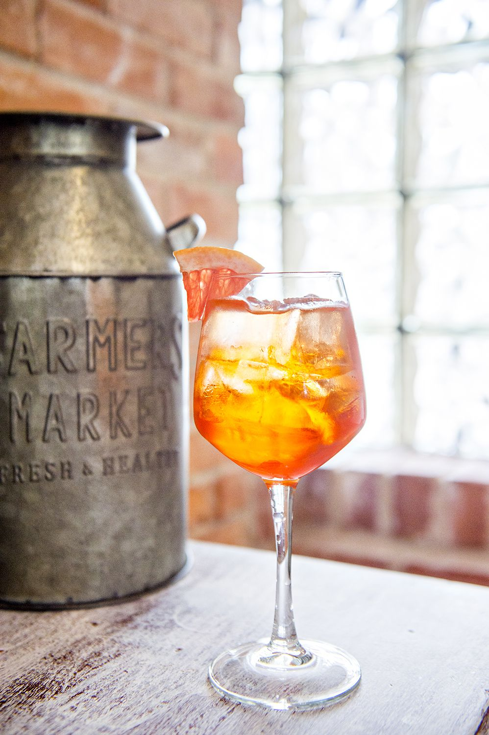 The Aperol Spritz with a garnish of grapefruit at Ivy on 7th