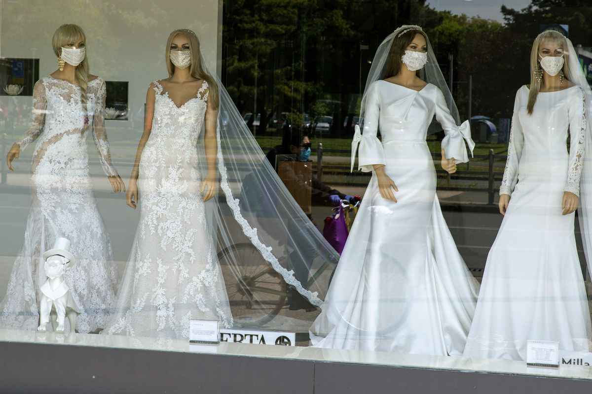 A wedding dress store in Zagreb, Croatia features mannequins wearing face masks. Face masks used to seem strange, but they're becoming increasingly commonplace in America and Europe.