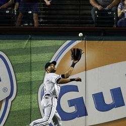 Chicago White Sox center fielder Alex Rios (51) chases down a fly-out by Texas Rangers' Ian Kinsler in the fourth inning of a baseball game on Saturday, April 7, 2012, in Arlington, Texas.