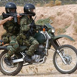 Members of an elite Greek special forces conduct a security exercise.