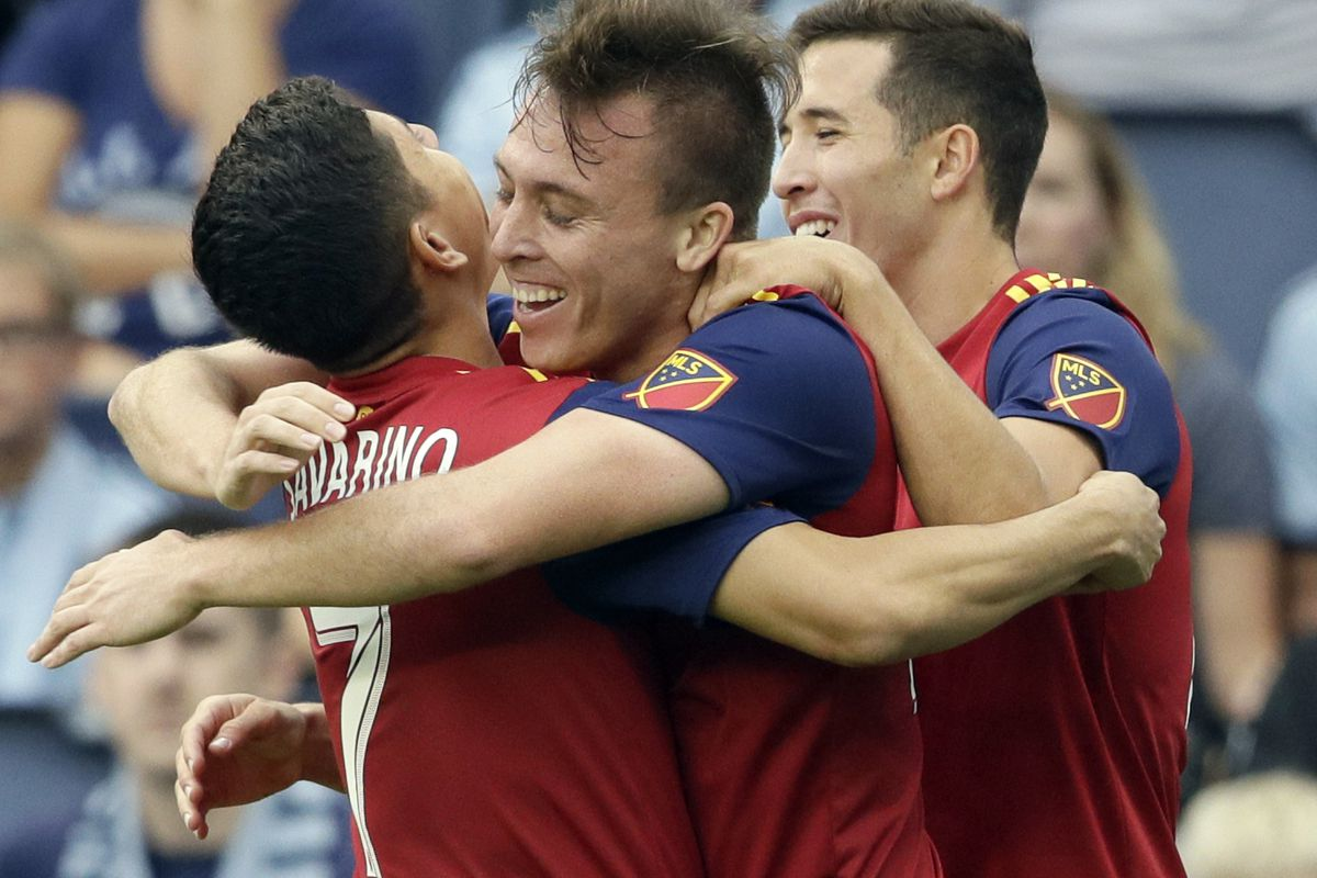 FILE - In this Sunday, Sept. 30, 2018, file photo, Real Salt Lake forward Corey Baird (27) celebrates his goal with teammates Jefferson Savarino (7) and Aaron Herrera (22) during the first half of an MLS soccer match against Sporting Kansas City in Kansas
