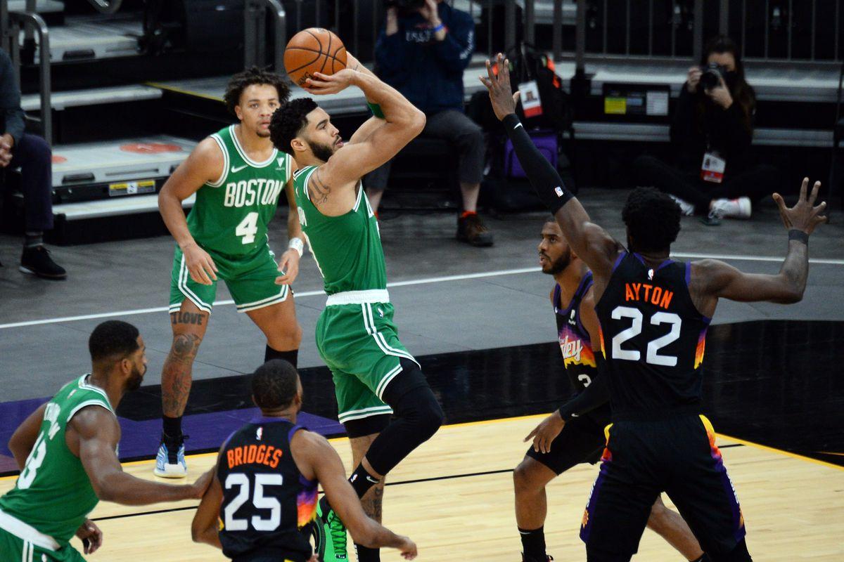 Boston Celtics forward Jayson Tatum (0) shoots against the Phoenix Suns during the first half at Phoenix Suns Arena.