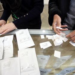 Workers put stickers on product as Dragonfly Wellness in Salt Lake City prepares to open as the first of Utah's 14 medical cannabis pharmacies on Monday, March 2, 2020.