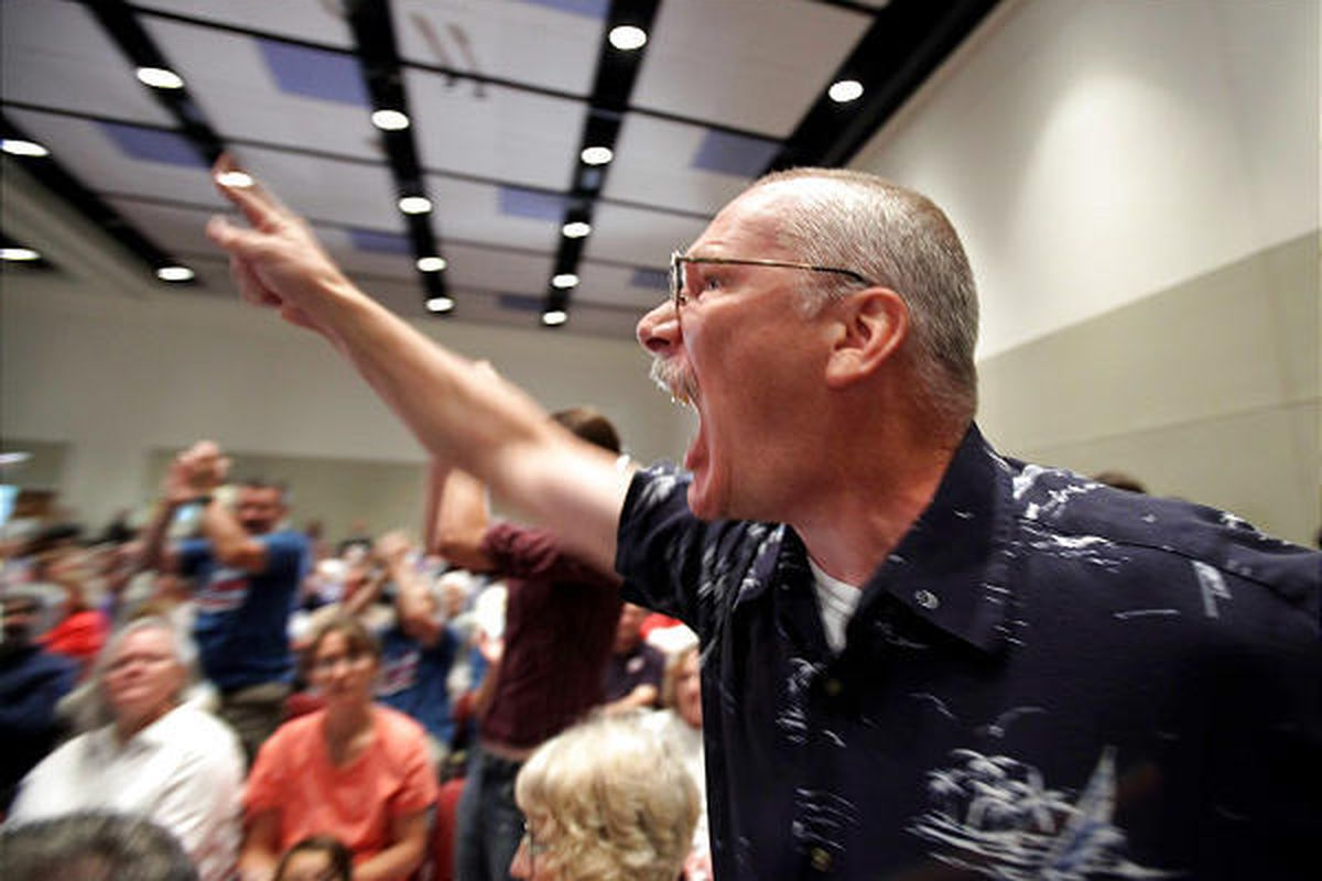 Randy Hook yells at Sen. Arlen Specter during a meeting on health care at Penn State University on Wednesday.