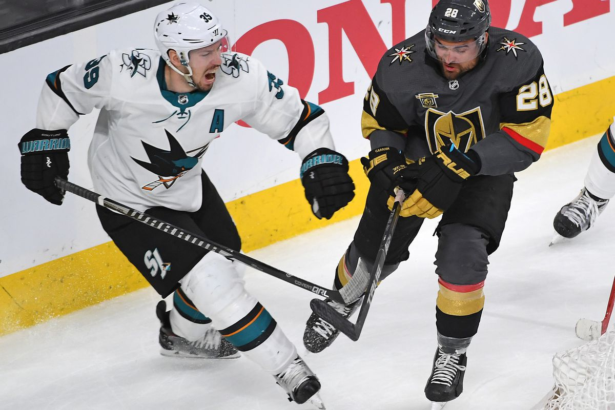 Apr 26, 2018; Las Vegas, NV, USA; Vegas Golden Knights left wing William Carrier (28) moves to check San Jose Sharks center Logan Couture (39) during the third period of game one of the second round of the 2018 Stanley Cup Playoffs at T-Mobile Arena.