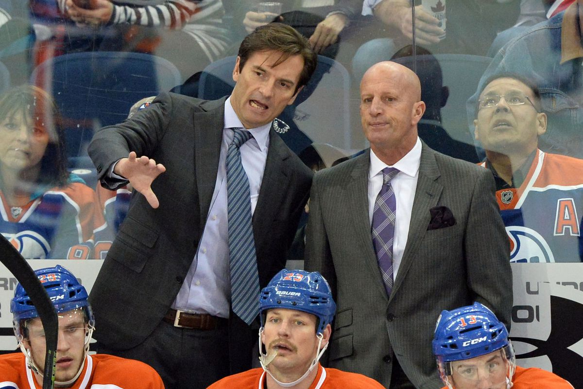 Former coach Dallas Eakins projects ParZona-like calculations onto the ice with associate coach Keith Acton.