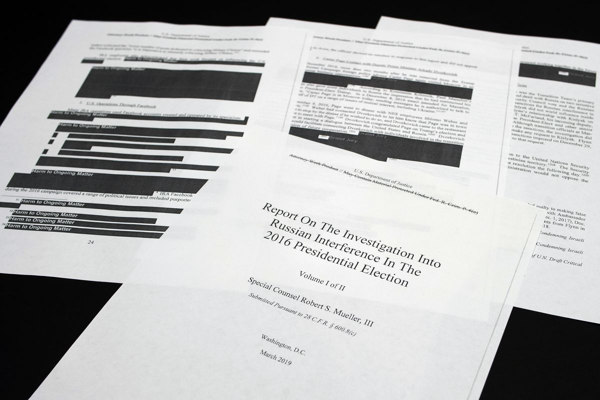 FILE - Four pages of the Mueller Report lay on a witness table in the House Intelligence Committee hearing room on Capitol Hill, in Washington, Thursday, April 18, 2019.