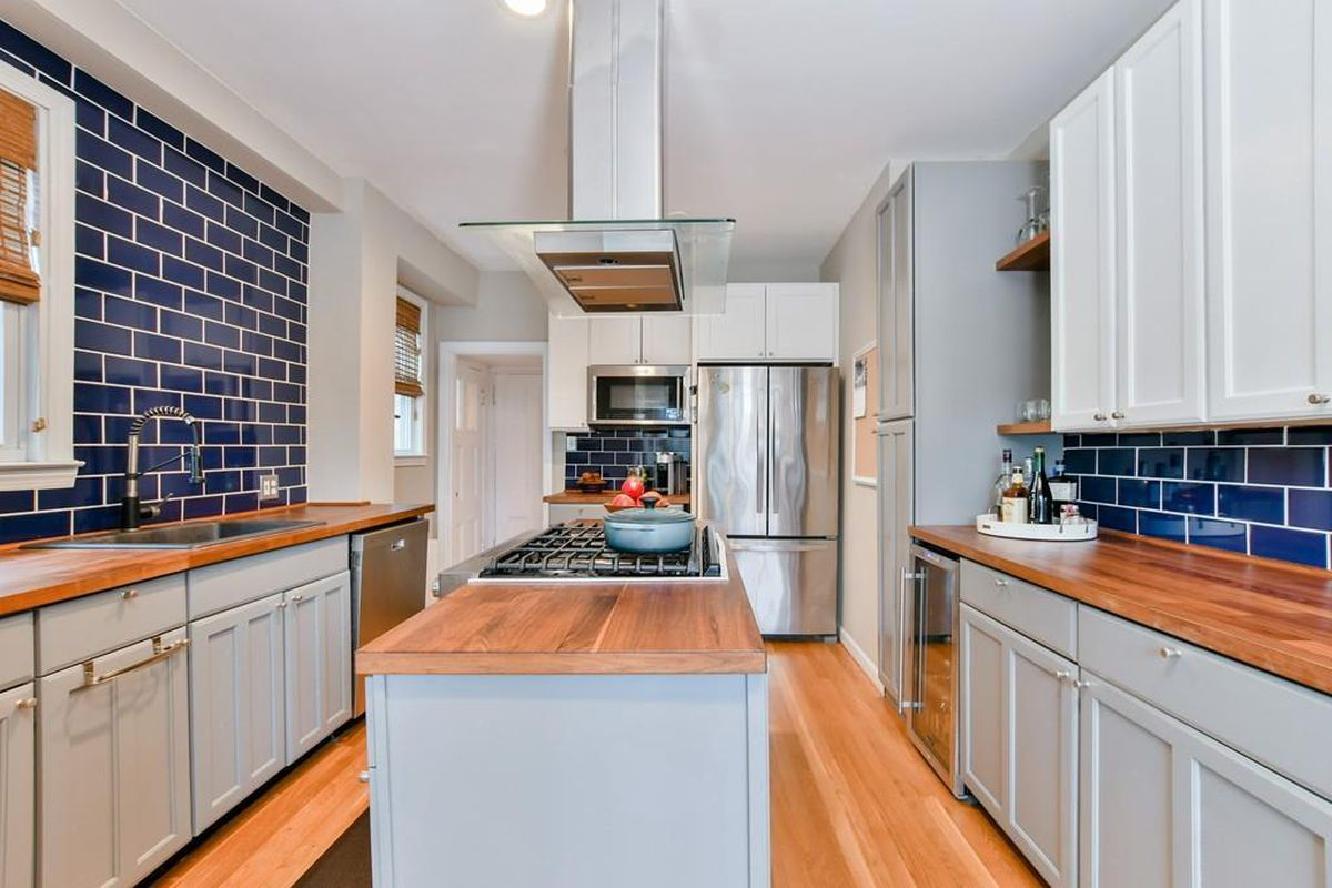 A bright kitchen with a large island.